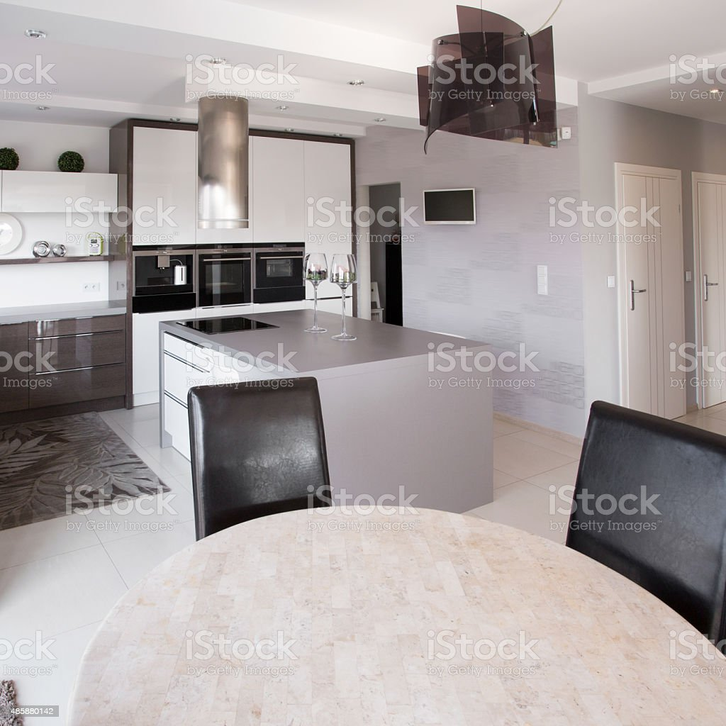Modern furniture in designed kitchen stock photo