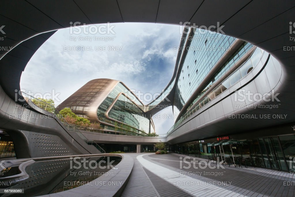 Modern futuristic architecture office building designed by Zaha Hadid stock photo
