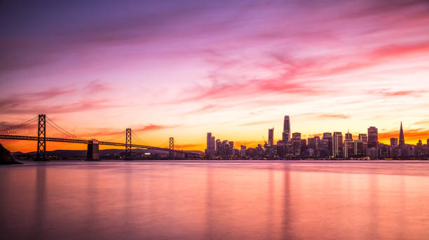 Modern futuristic downtown San Francisco skyline at night Modern futuristic downtown San Francisco skyline at night, California, USA. san francisco california stock pictures, royalty-free photos & images