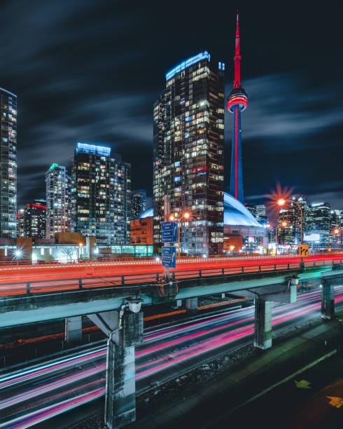modern futuristic night toronto city skyline - toronto stock pictures, royalty-free photos & images