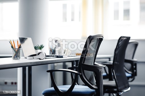 istock Modern gadgets in interior of coworking office during COVID-19 epidemic 1284066336