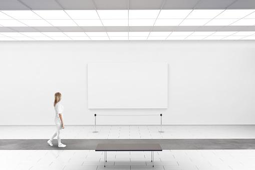 Modern gallery wall mockup. Woman walk in museum hall