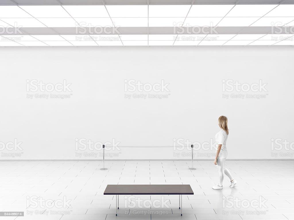 Modern gallery wall mockup. Woman walk in museum hall stock photo