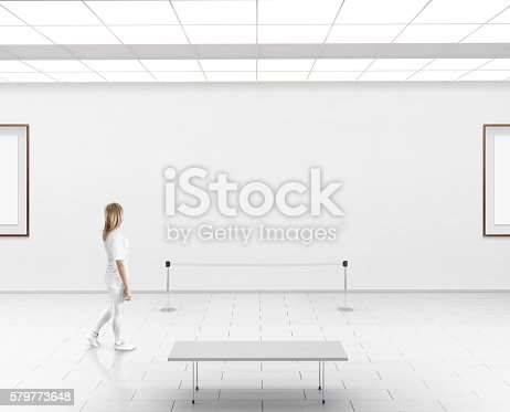 istock Modern gallery wall mockup. Woman walk in museum hall 579773648