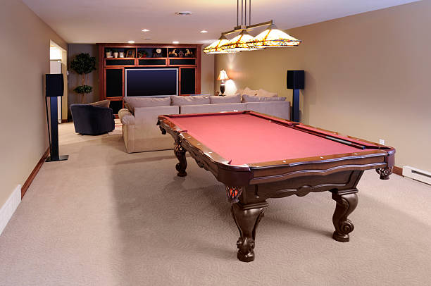Modern Game Room; Pool Table, Custom Lighting, HDTV, Surround Sound stock photo