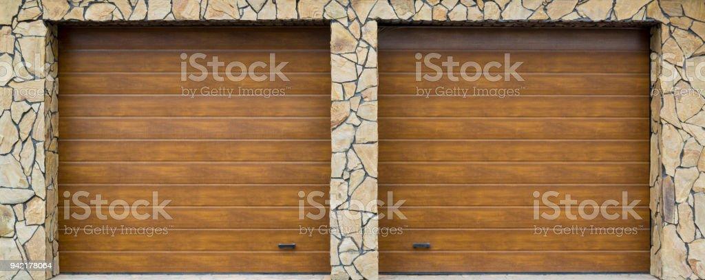 Modern garage door. Large automatic up and over garage door with...