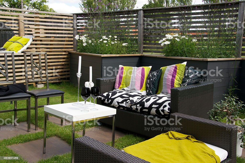 Modern garden and Patio with outdoor furnitures royalty-free stock photo