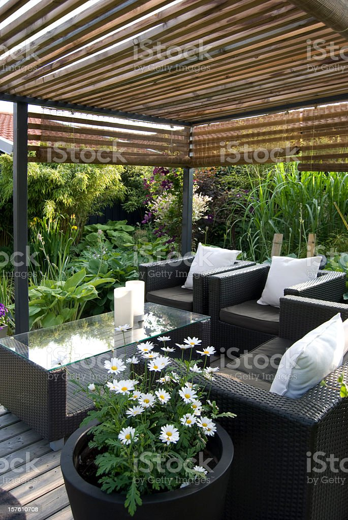 Modern Garden With A Pergola And Wicker Sofa Royalty Free Stock Photo