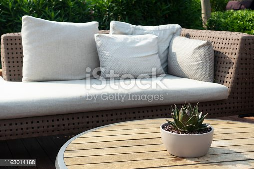 Bright terrace with a rattan corner soa. Modern garden with outdoor furnitures.garden and Patio with outdoor furnitures.Garden lounge.