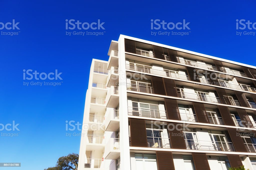 Modern, geometric apartment building in bright sunshine royalty-free stock photo