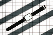 modern geometry wristwatch on square pattern and shadow background