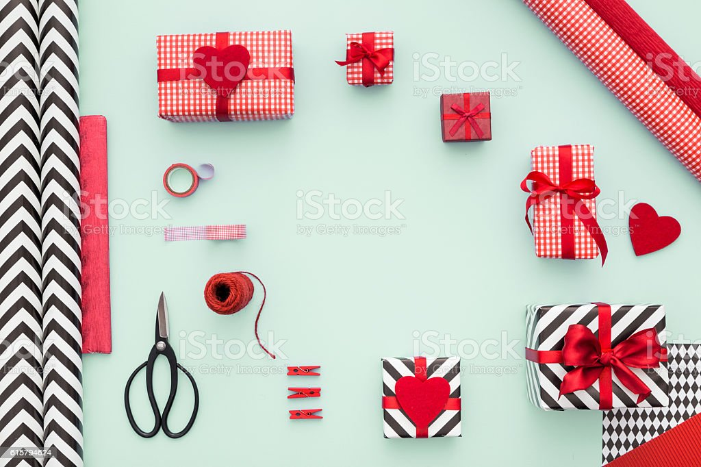 Gift boxes wrapped in red checked paper and the contents of a...