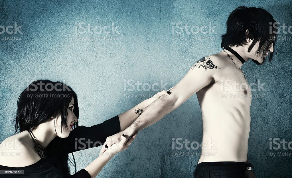 Modern girl gripping his boyfriend´s arm tightly royalty-free stock photo
