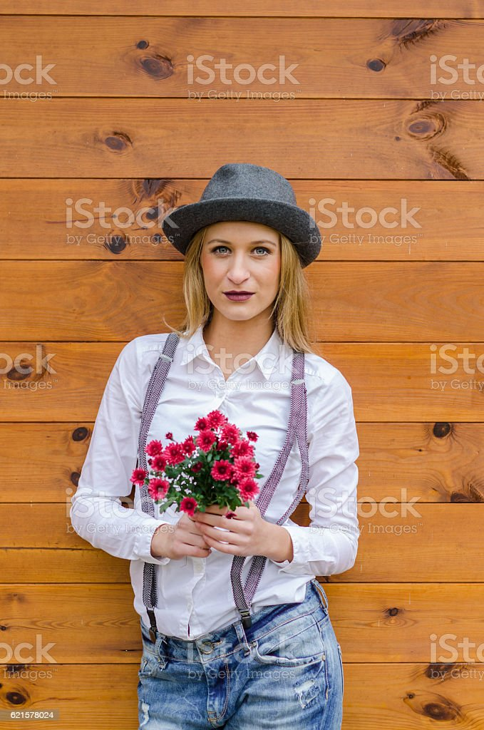 Modern girl in jeans, shirt and suspenders photo libre de droits