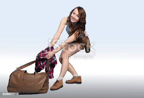 926982852 istock photo Modern Girl Pulling a Big Load. 639689816