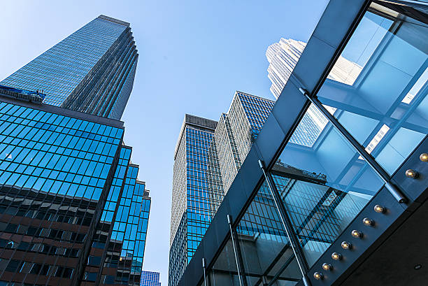 Modern Glass and Steel Skyscraper Office Building in Minneapolis Modern Glass and Steel Skyscraper Office Building in Downtown Minneapolis. elevated walkway stock pictures, royalty-free photos & images