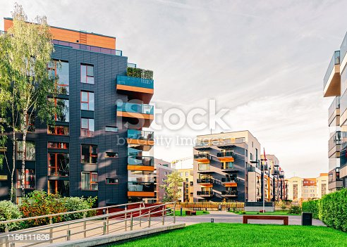 1165384568 istock photo Modern glass apartment residential buildings 1156111626