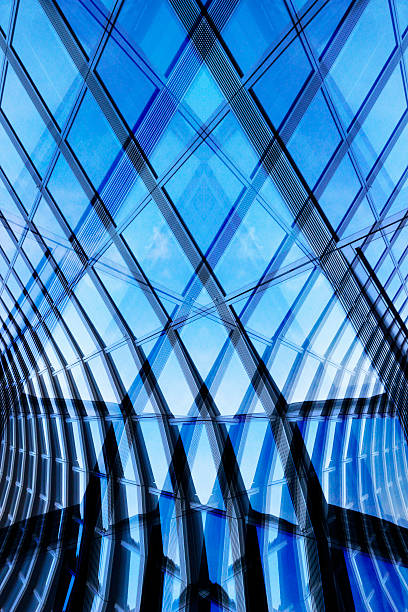Modern glass architecture. Double exposure photo of structural glass walls. Double exposure photo of glazed aluminum structures. Realistic though fictional contemporary architecture fragment resembling a subway tunnel / underpass. man made structure stock pictures, royalty-free photos & images