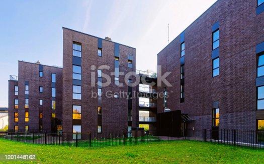 493502515 istock photo Modern glass architecture of apartment house reflex 1201448162