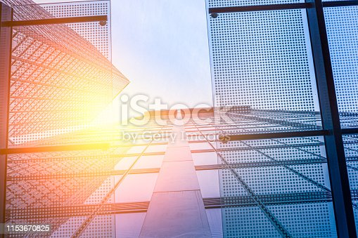 istock Modern glass architecture with sun reflection 1153670825