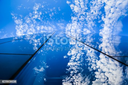 istock Modern glass building and blue sky 625909538