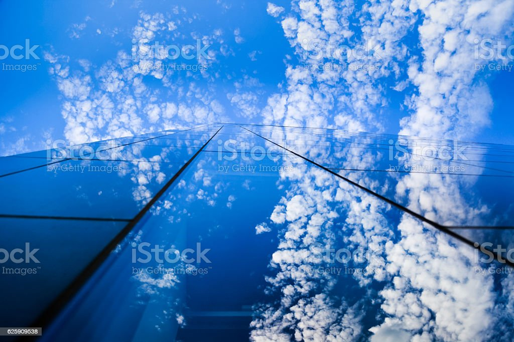 Modern glass building and blue sky stock photo