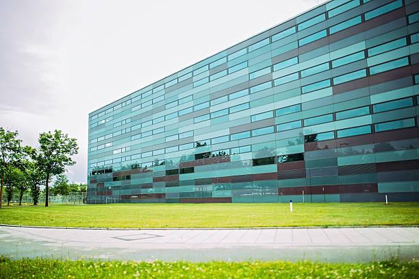 modern glass building in germany - münchen weather stock-fotos und bilder