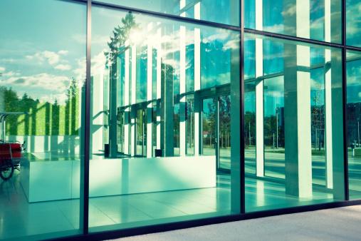 modern corporate glass building,  cross processing,