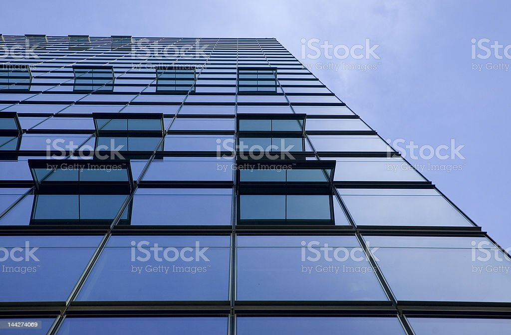 Modern glass facade architecture with solar energy panel royalty-free stock photo