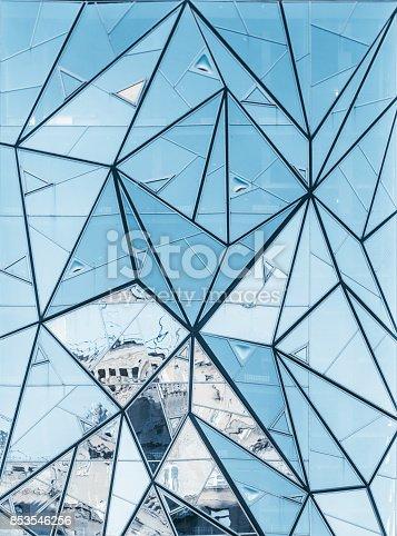 istock Modern glass facade reflecting street 853546256