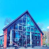 Druskininkai, Lithuania - May 1, 2017: Modern glass hotel building in city center of Druskininkai, Lithuania. Toned
