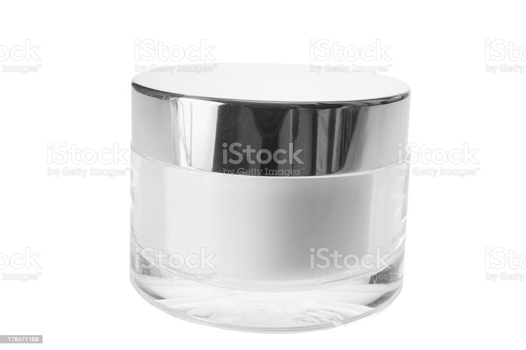 Modern glass jar of facial cream with reflective lid royalty-free stock photo
