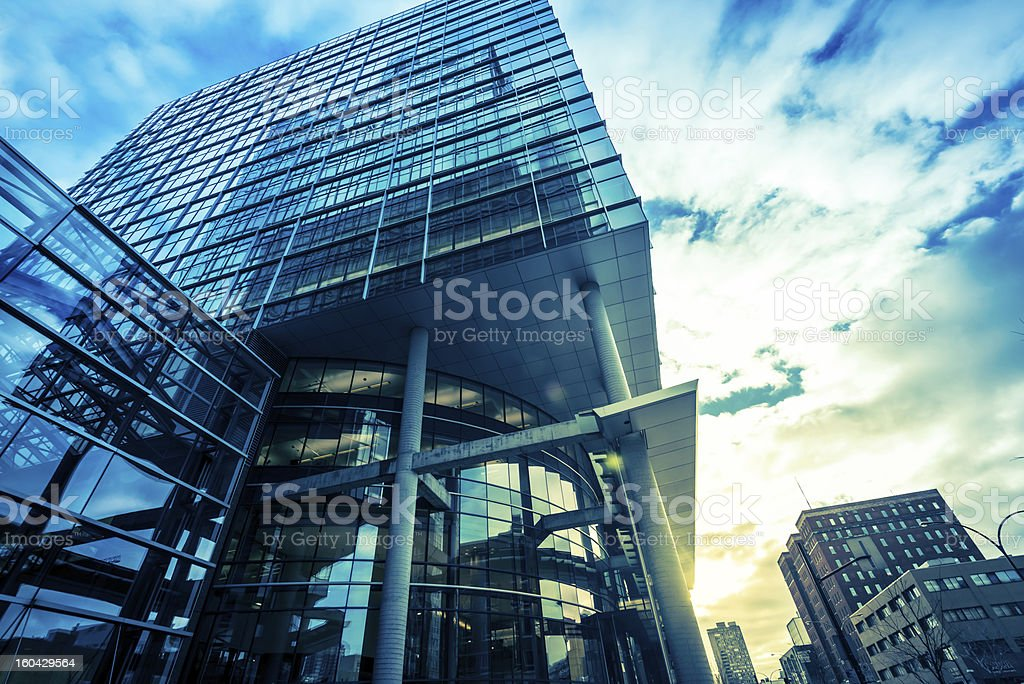Modern glass office building at sunrise stock photo