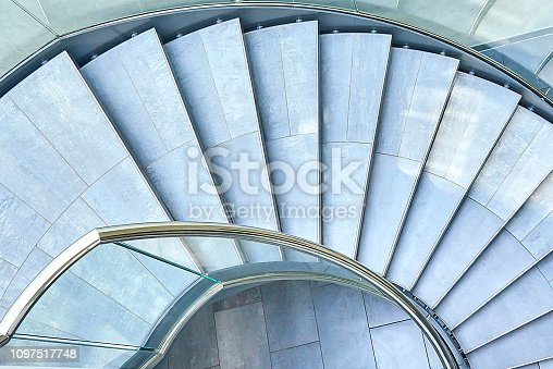 180698194 istock photo Modern glass office spiral staircase 1097517748