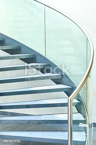 180698194 istock photo Modern glass office spiral staircase 1097517774