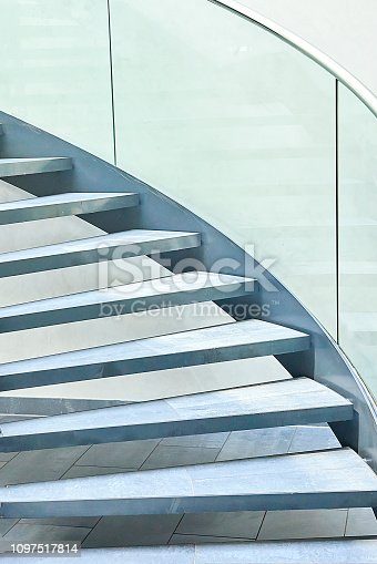 180698194 istock photo Modern glass office spiral staircase 1097517814