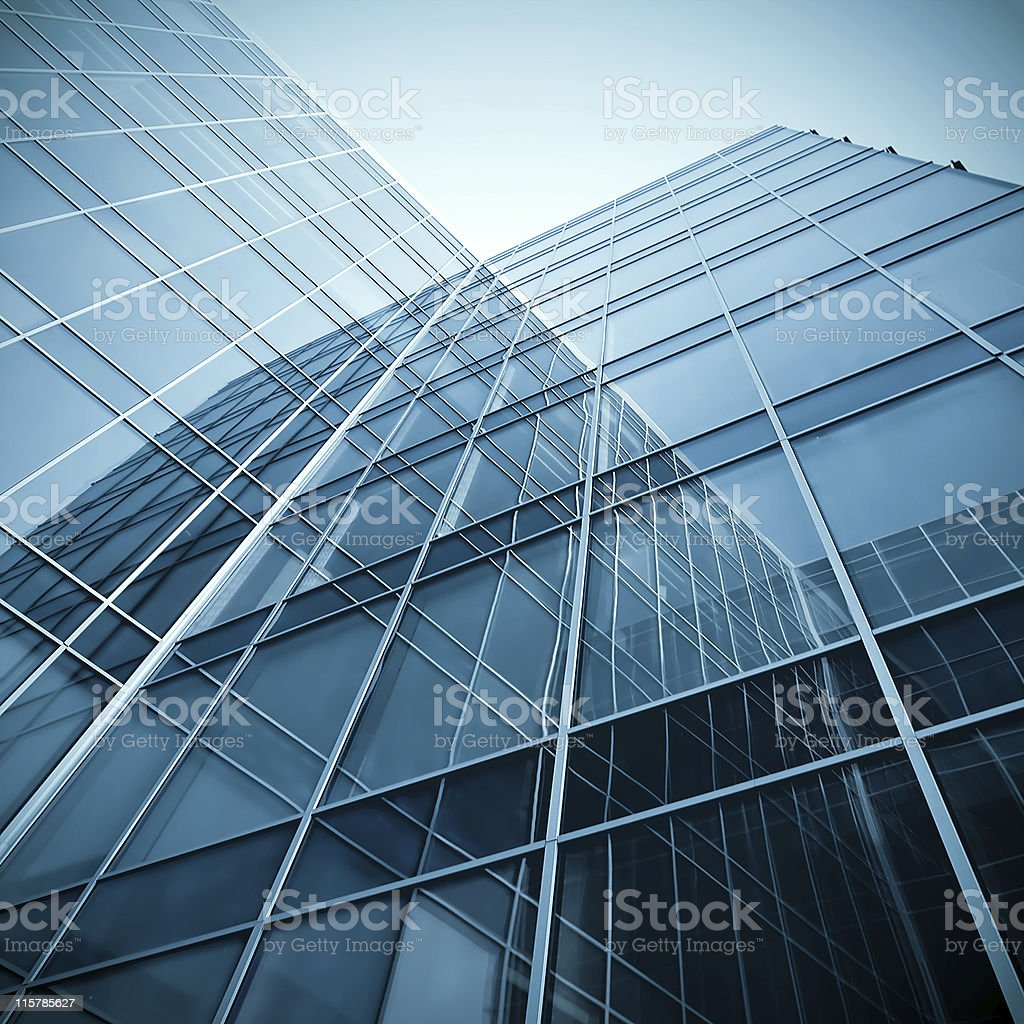 modern glass silhouettes of skyscrapers at night stock photo
