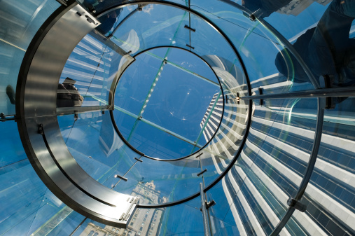 Modern Glass Staircase Silhouette of walking People in New York