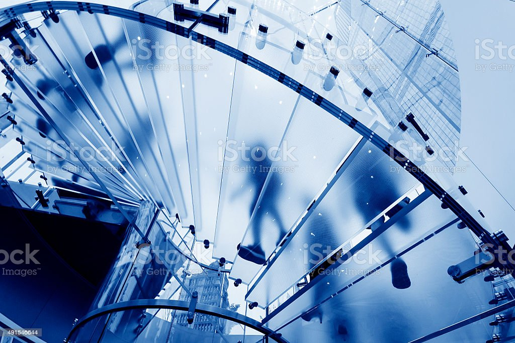 Modern Glass Staircase Silhouette of walking People in shanghai china stock photo