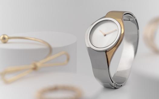 istock Modern golden and silver wrist watch between golden accessories 1172051110