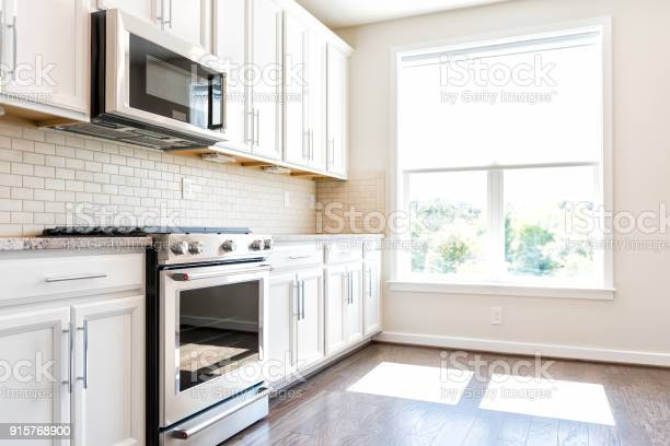 Modern gray brown neutral kitchen features front cabinets with and picture id915768900?b=1&k=6&m=915768900&s=612x612&h=0mdd1cmvxtzqmts8ivfmp rjukec6fppn8xbjjisc80=