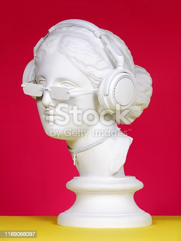 Plaster head model (mass produced replica of Head of Aphrodite of Knidos) with headphones, sunglasses, choker and piercing