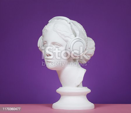 Plaster head model (mass produced replica of Head of Aphrodite of Knidos) with headphones