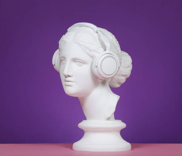 modern greek goddess with headphones - statua foto e immagini stock