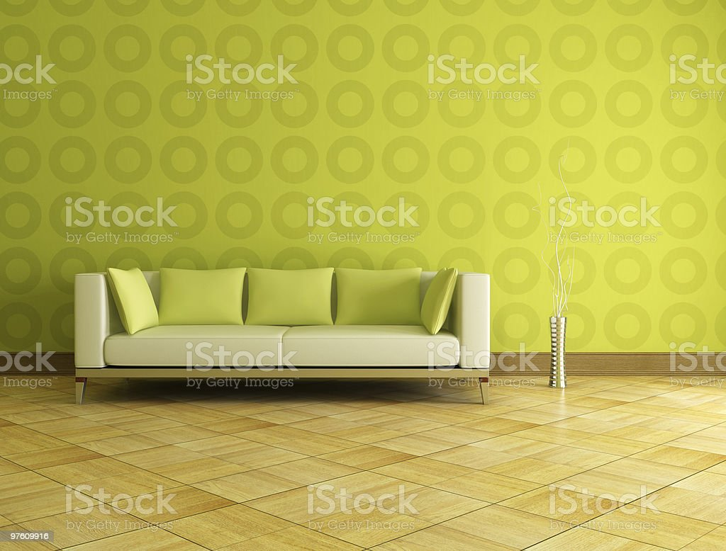 Modern green couch and wallpaper with a wood floor royalty-free stock photo