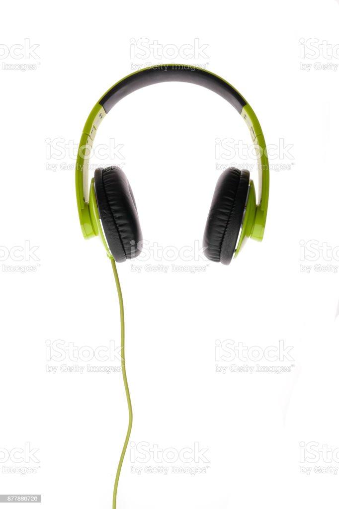 Modern green headphone on white background close up stock photo