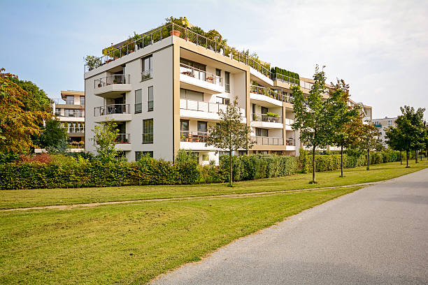 Modern green residential building, apartments in a new urban development Modern green residential building, apartments in a new urban development gated community stock pictures, royalty-free photos & images