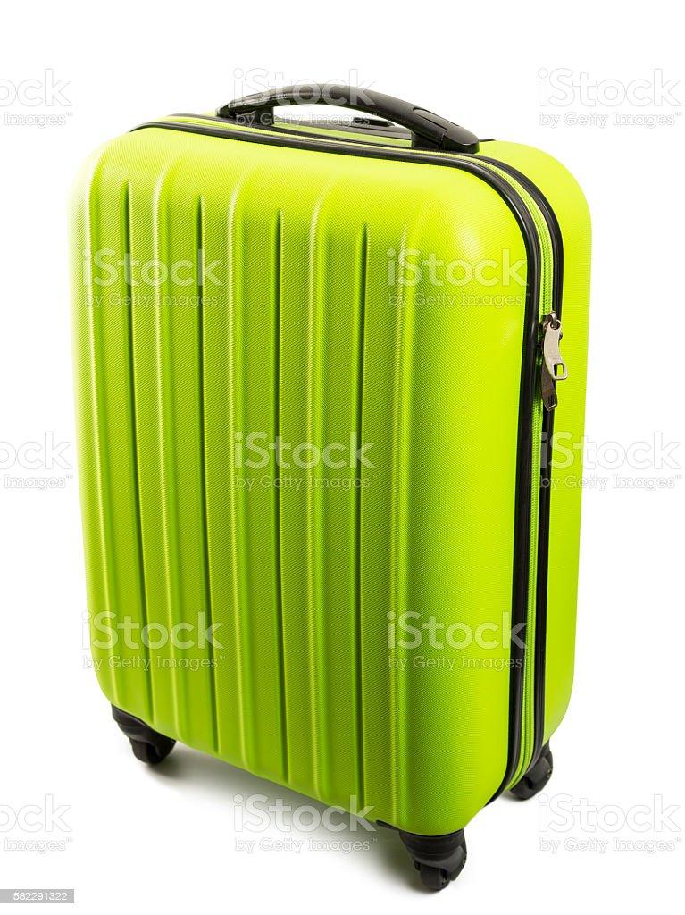 Modern green travel suitcase isolated on white background stock photo