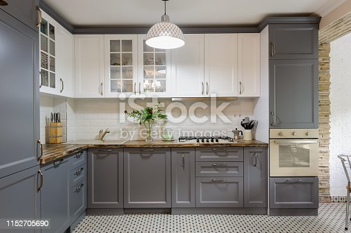 interior of modern luxury grey and white wooden kitchen