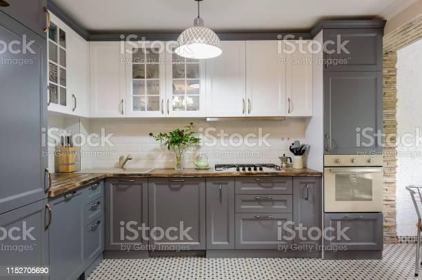 Modern grey and white wooden kitchen interior picture id1152705690?b=1&k=6&m=1152705690&s=612x612&h=soad7kqkes5p1kbixwf080zjs erfqkktjdjnymkdr0=